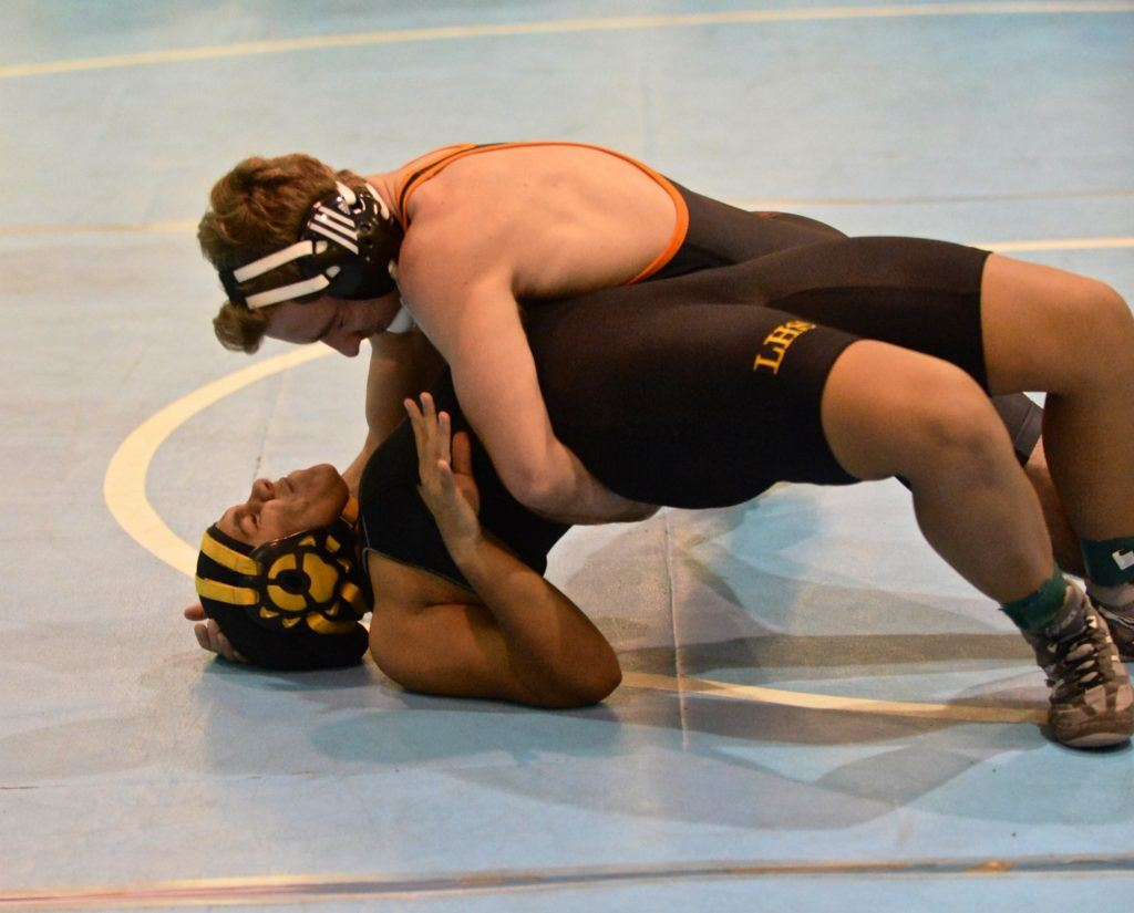 Alexandria's Aaron Whittaker goes for the pin against Lincoln's Katie Threatt. (Photo by B.J. Franklin/GungHo Photos)