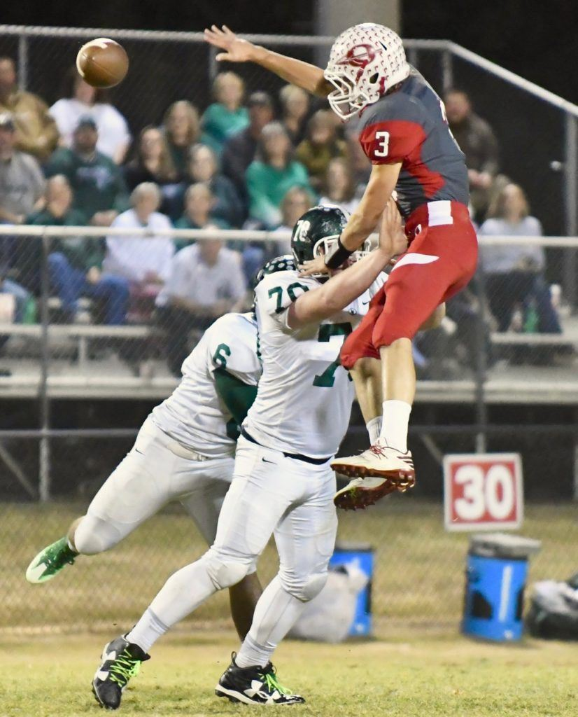 Ohatchee's Austin Tucker (3) tries to go over Locust Fork lineman Preston Castleberry (70) to bat down a pass thrown by Michael Clevenger. (Photo by B.J. Franklin/GungHo Photos)