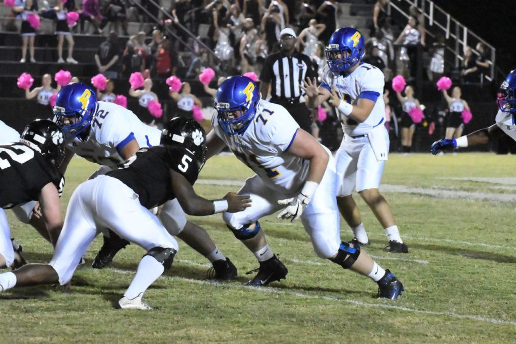 The protection Piedmont quarterback Taylor Hayes (11) has been getting from linemen like Blake Headrick (72) and Mason Langley (71) has been a big part of the Bulldogs' success on offense. (Photo by B.J. Franklin/GungHo Photos)