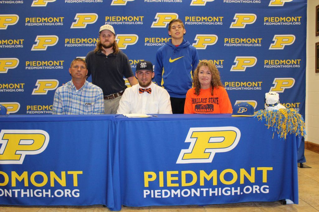 Piedmont senior Easton Kirk (front center) is joined at his signing ceremony by (from left) father Shane, brothers Kyle and Weston, and mother Kellie. (Photo by Shannon Fagan)