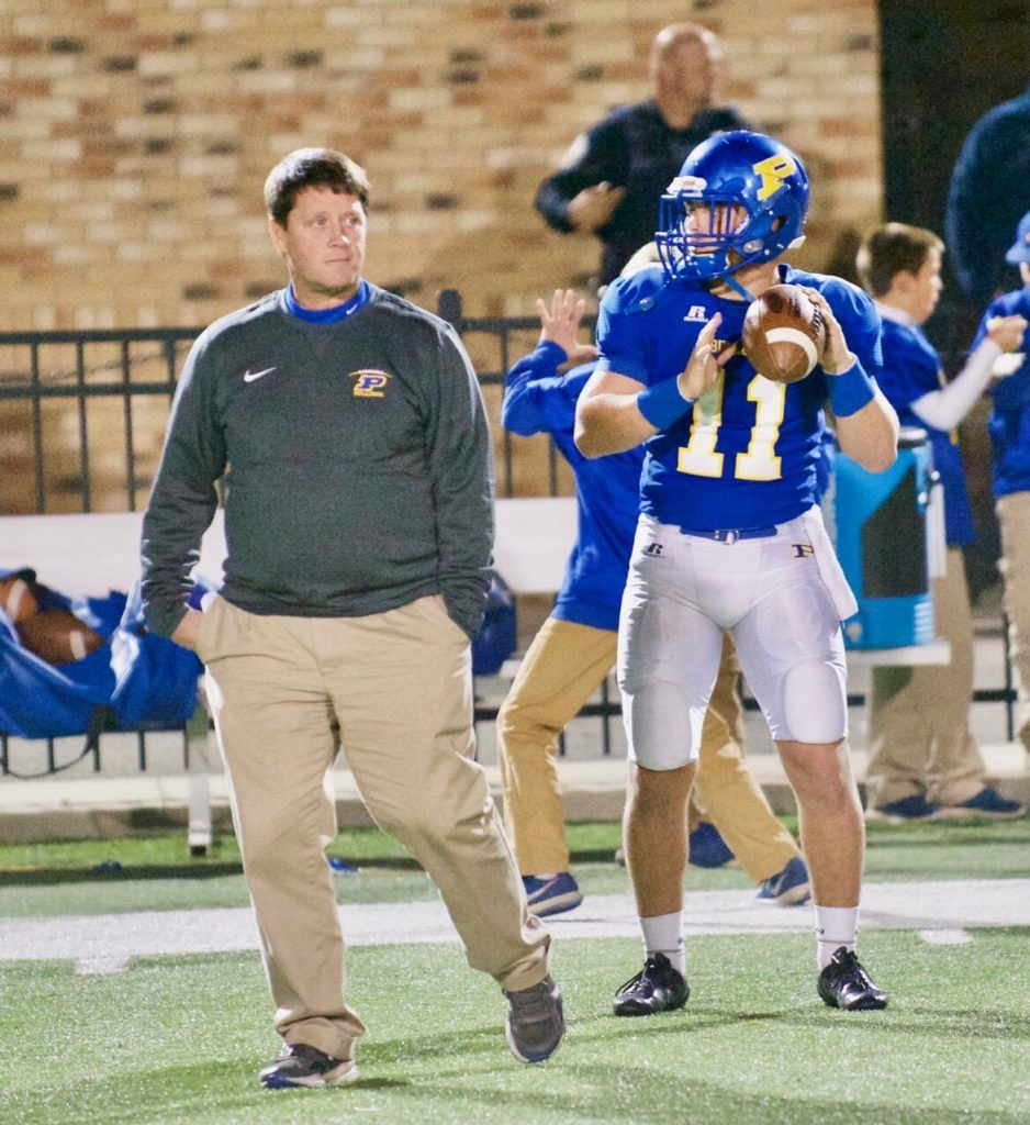 Piedmont quarterback Taylor Hayes warms up under the watchful eye of Bulldogs head coach Steve Smith. Hayes has accounted for 3,116 yards and 50 TDs this season, 7,221 yards and 99 TDs in his career. (Photo by B.J. Franklin/GungHo Photos)