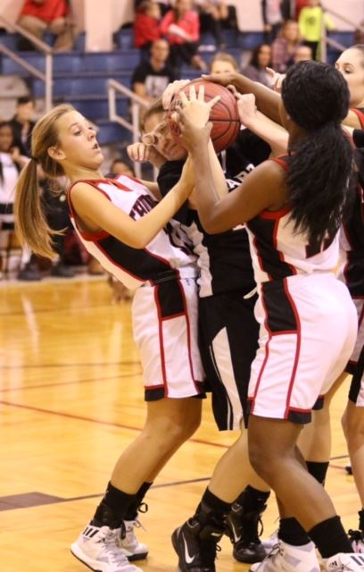 Sacred Heart's Jacque Beyerle gets tangled up with JCA's Briah Cupp (L) and Haley Moses.