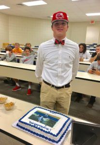 Jacksonville right-hander Colin Casey stands next to the cake that bears his likeness to celebrate signing with Jacksonville State Wednesday.