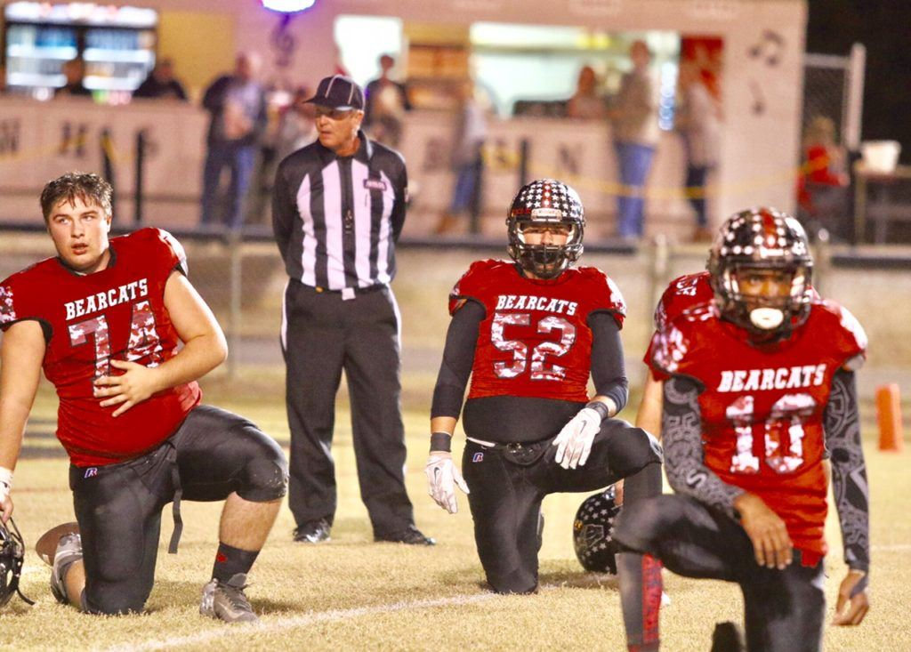 Weaver's Jasper Duke (74), Tyler Perez (52) and Chris Lemon helped the Bearcats post their first playoff shutout in history Friday.