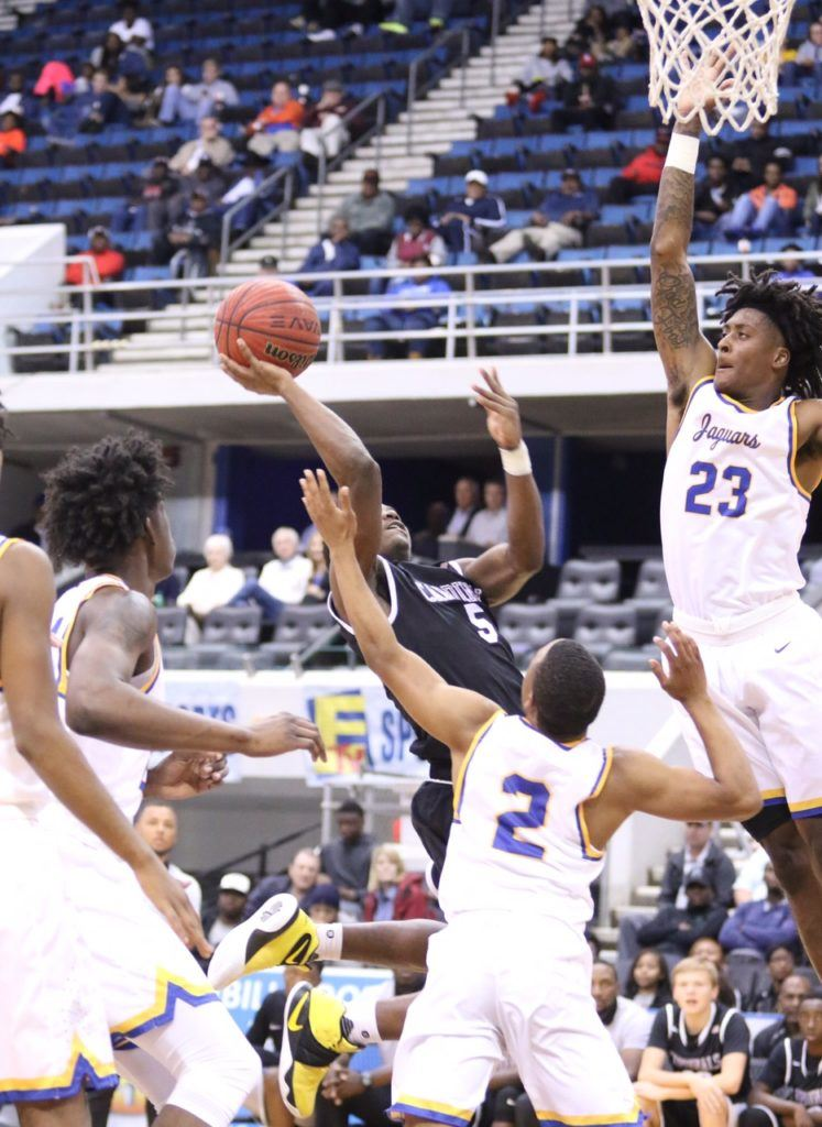 Alabama signee John Petty (23) goes high to disrupt Sacred Heart guard D.J. Heath's shot in Monday's game. Below, Petty goes stride-for-stride with Dionte Wood. (Photos by Kristen Stringer/Krisp Pics Photography)
