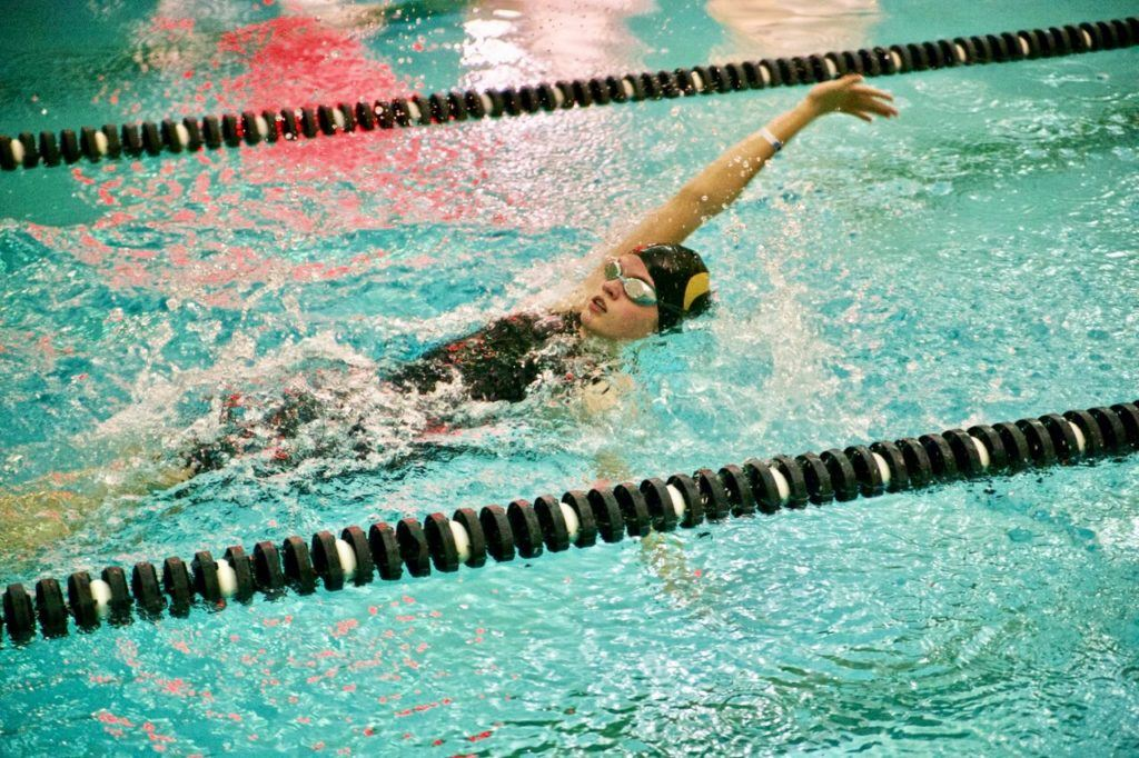 Heather Wright of girls team champion Oxford cuts through the water in her 100 backstroke race. (Photo by B.J. Franklin/GungHo Photos)