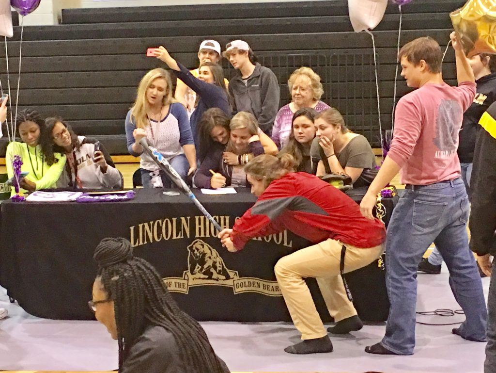 Carlee Mullinax (seated center) and her friends do a Mannequin Challenge after the Lincoln third baseman signed scholarship papers to play softball at Montevallo.