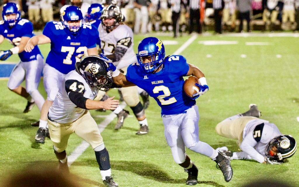 Piedmont running back Lee Stanley leaves one Colbert County defender in the dust and tries to get around another in last week's playoff game. (Photos by B.J. Franklin/GungHo Photos)