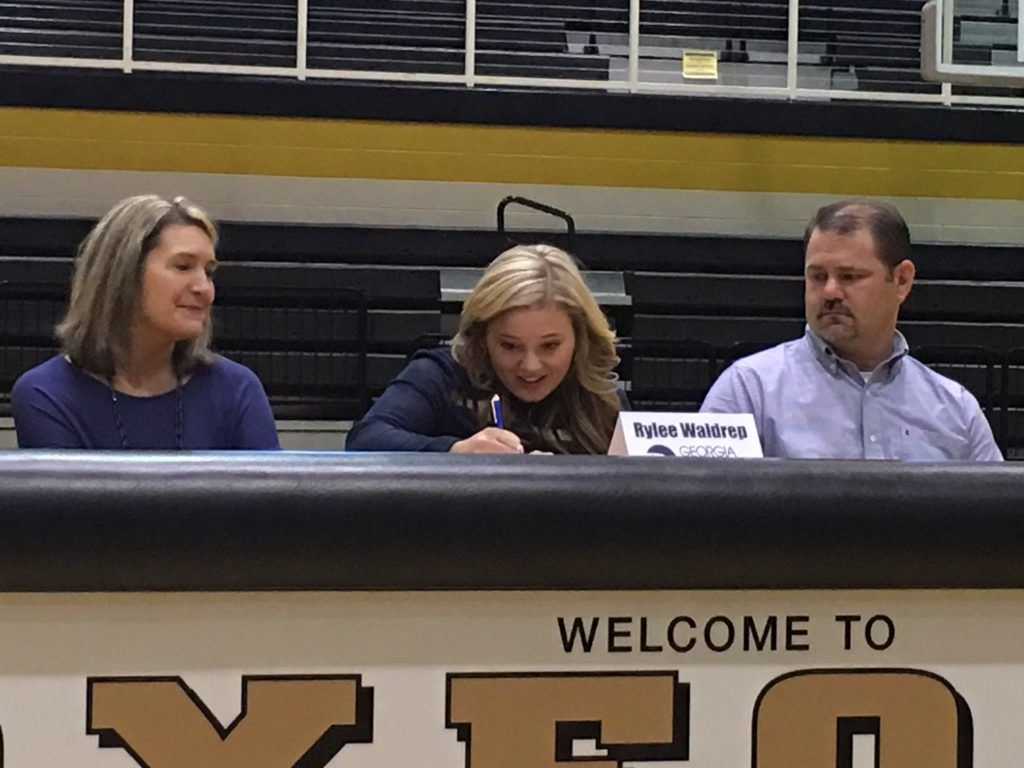 Oxford pitcher Rylee Waldrep, flanked by her parents, signs with Georgia Southern Wednesday.