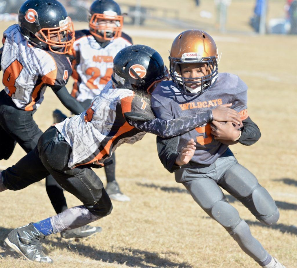 Jacory Russell wraps up a Fultondale ballcarrier during the East Alabama Gators' 10U title game.