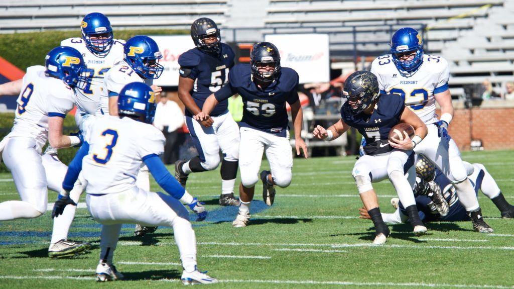 The Piedmont defense closes in on Mobile Christian quarterback Cam Horne. The Bulldogs set a Class 3A title game record by holding the Leopards to 27 yards net rushing.
