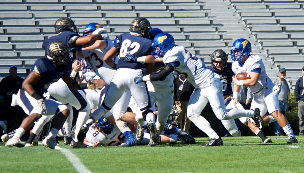Piedmont's massive offensive front keeps Mobile Christian occupied long enough for Taylor Hayes to find a hole.