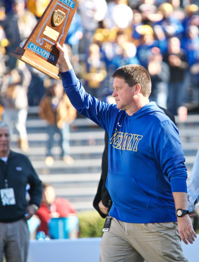 Piedmont coach Steve Smith walks back to his players with the blue championship trophy that will go nicely with the one he brought to them in 2015. (All photos by B.J. Franklin/GungHo Photos)