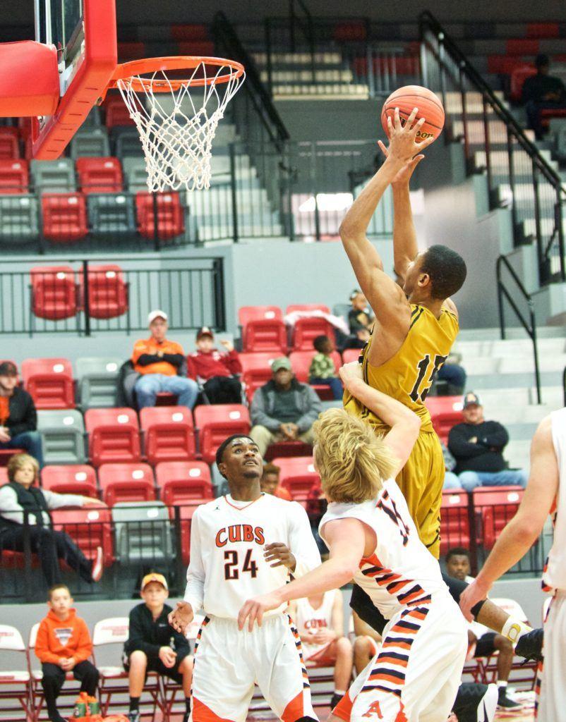 Oxford freshman Zondrick Garrett goes hard to the basket against Alexandria. (Photo by B.J. Franklin/GungHo Photos)