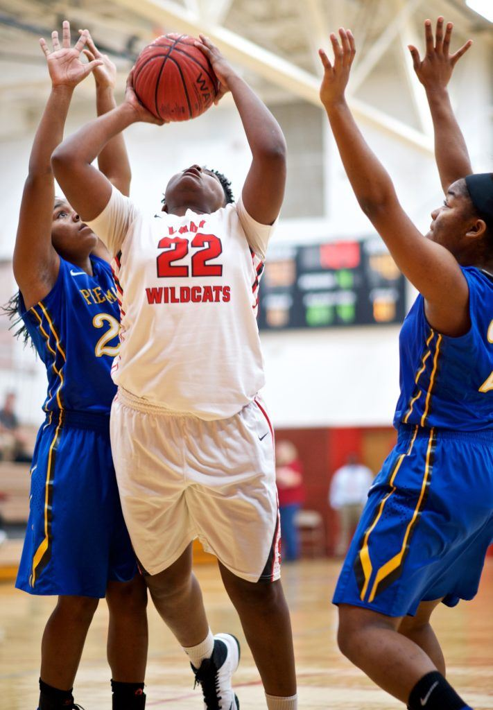 Saks' TeeTee Jenkins (22) splits the Piedmont defense to get to the basket. (Photo by B.J. Franklin/GungHo Photos)