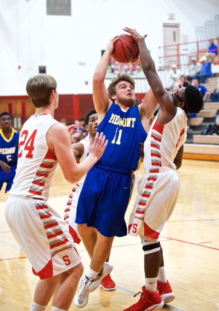 Piedmont's Taylor Hayes (11) drives between Saks' Chuck Taylor (R) and Jalen Borders. (Photo by B.J. Franklin/GungHo Photos)