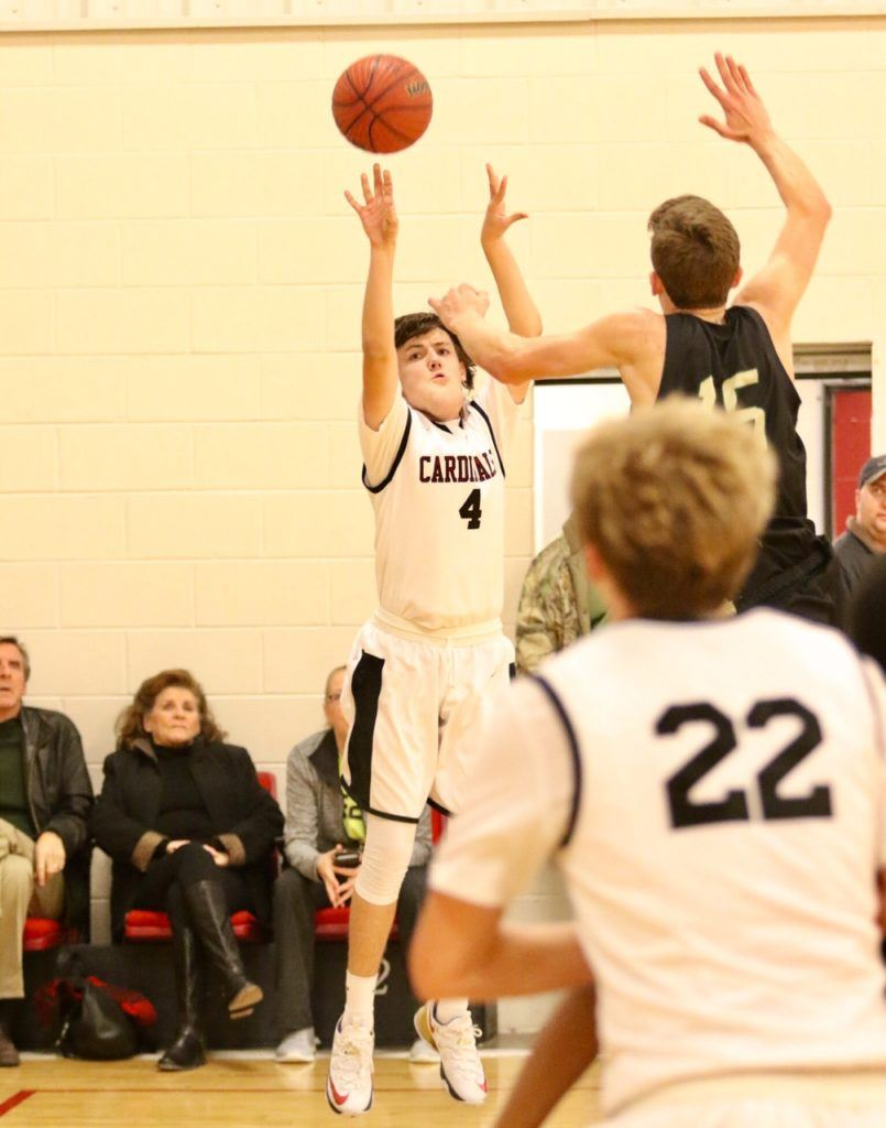 Jack Miller (4) had a confident shot for a freshman playing his first varsity game in Sacred Heart's 89-69 win over Faith Christian. (Photo by Kristen Stringer/KrispPics Photography)
