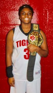 Cleburne County's Shawntavia Boyd proudly displays the 'Charge Belt' that recognizes a Lady Tigers ability to take a charge.