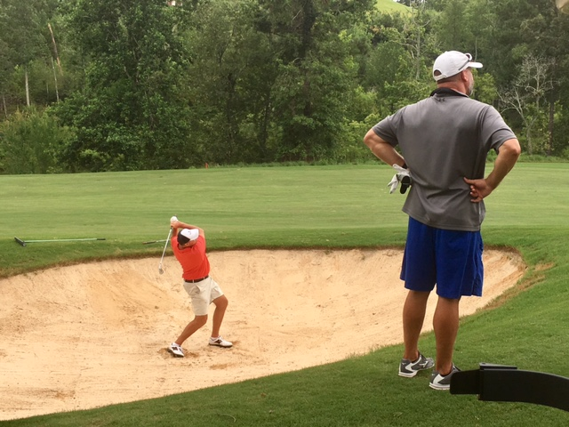 awesome cider ridge #4: Ty Cole watches partner Gary Wigington get back in play from the fairway  bunker on 18 Saturday at Cider Ridge. Wigington went on to make a clutch  birdie ...